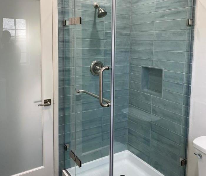 Shower rebuilt blue tile.