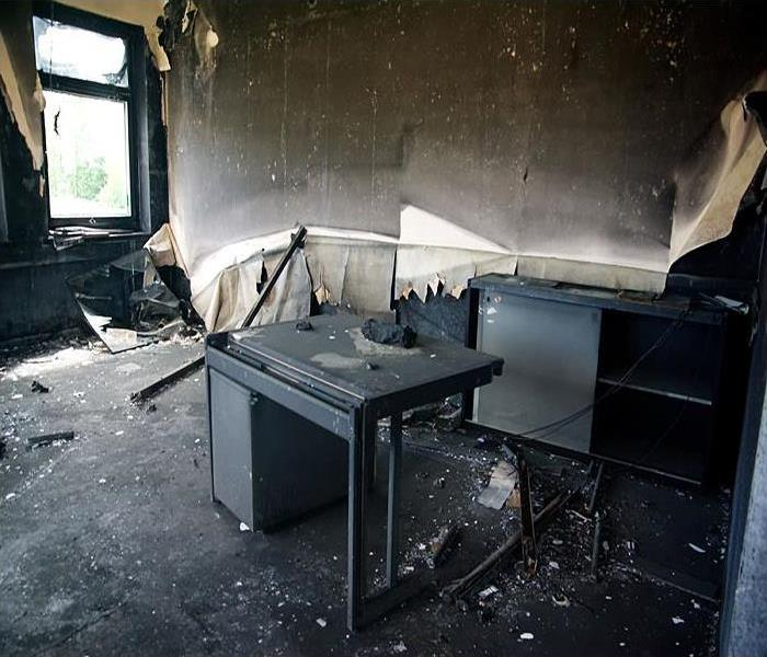 Burned interiors and furniture in office building