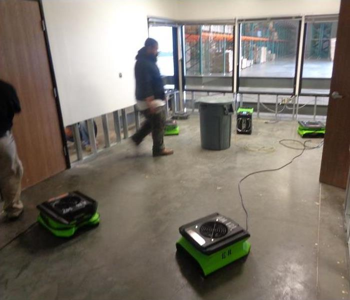 SERVPRO technician and equipment at work.