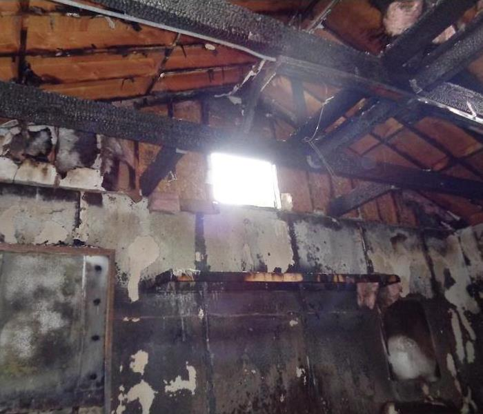 Walls and roof rafters charred and burned in a home