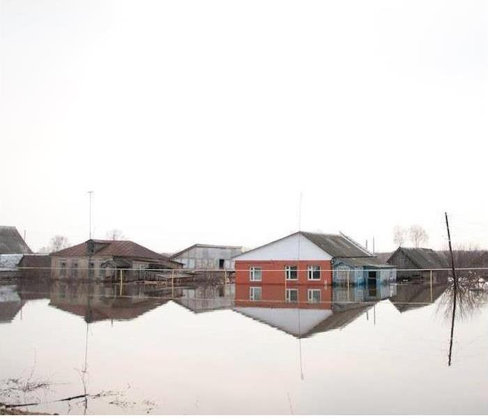 Homes surrounded by standing water.