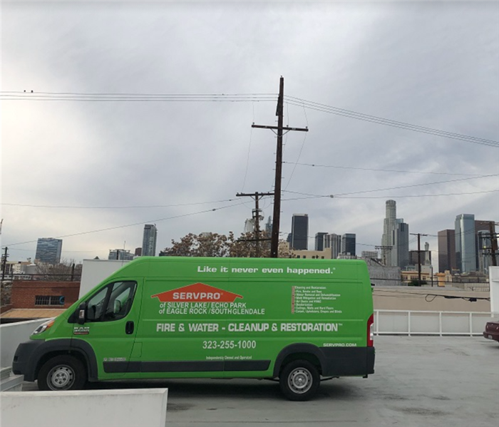 SERVPRO vehicle in parking lot; city in background